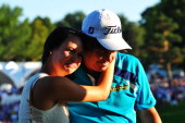 Jason Dufner of the United States hugs his wife Amanda on the 18th green after his twostroke victory at the 95th PGA Championship at Oak Hill Country...