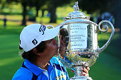 Jason Dufner of the United States kisses the Wanamaker Trophy after his twostroke victory at the 95th PGA Championship at Oak Hill Country Club on...