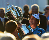 Jason Dufner of the United States looks at the Wanamaker Trophy after his twostroke victory at the 95th PGA Championship at Oak Hill Country Club on...