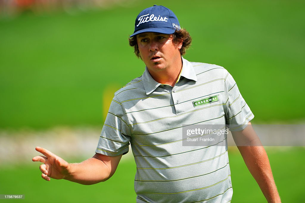 <a gi-track='captionPersonalityLinkClicked' href=/galleries/search?phrase=Jason+Dufner&family=editorial&specificpeople=561651 ng-click='$event.stopPropagation()'>Jason Dufner</a> of the United States makes birdie on the 11th hole during the second round of the 95th PGA Championship on August 9, 2013 in Rochester, New York.