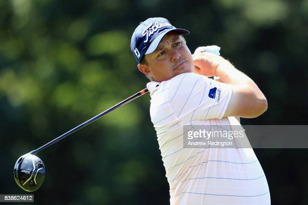 Jason Dufner of the United States plays his shot from the 18th tee during round one of The Northern Trust at Glen Oaks Club on August 24 2017 in...