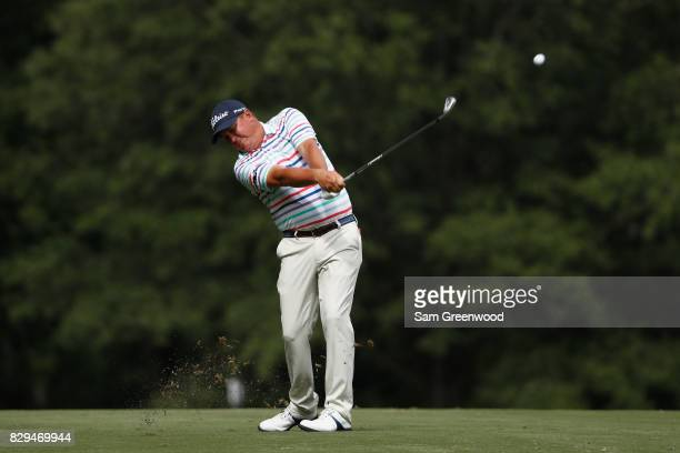 Jason Dufner of the United States plays his shot on the 11th hole during the first round of the 2017 PGA Championship at Quail Hollow Club on August...