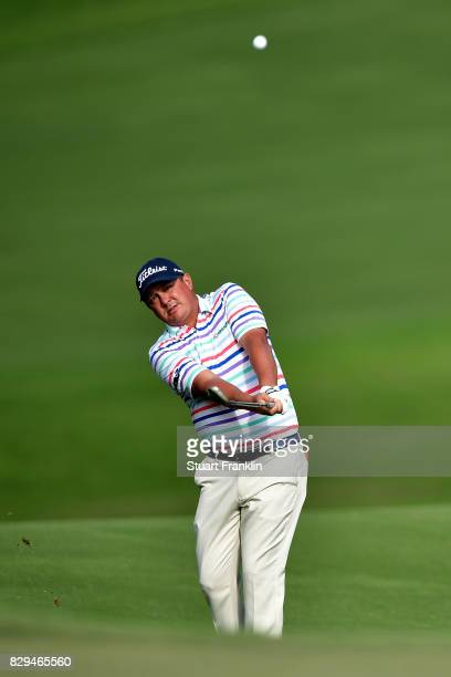 Jason Dufner of the United States plays his shot on the 15th hole during the first round of the 2017 PGA Championship at Quail Hollow Club on August...