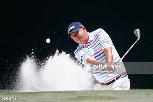 Jason Dufner of the United States plays his shot out of the bunker on the second hole during the first round of the 2017 PGA Championship at Quail...
