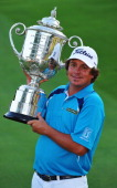 Jason Dufner of the United States poses with the Wanamaker Trophy after his twostroke victory at the 95th PGA Championship at Oak Hill Country Club...