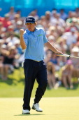 Jason Dufner of the United States pumps his fist after sinking a birdie putt at the eighteenth hole to win the HP Byron Nelson Championship at TPC...