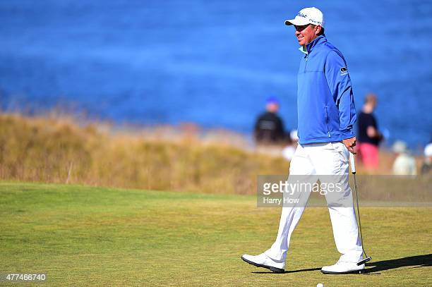 Jason Dufner of the United States walks across a green during a practice round prior to the start of the 115th US Open Championship at Chambers Bay...