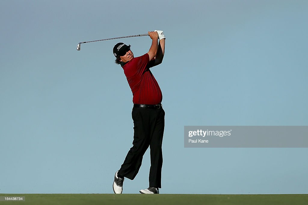 Jason Dufner of the USA plays his approach shot on the 18th hole during round three of the Perth International at Lake Karrinyup Country Club on October 20, 2012 in Perth, Australia.