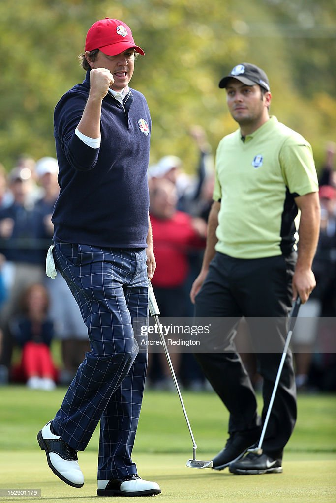 <a gi-track='captionPersonalityLinkClicked' href=/galleries/search?phrase=Jason+Dufner&family=editorial&specificpeople=561651 ng-click='$event.stopPropagation()'>Jason Dufner</a> of the USA reacts to a putt on the eighth green as <a gi-track='captionPersonalityLinkClicked' href=/galleries/search?phrase=Francesco+Molinari&family=editorial&specificpeople=637481 ng-click='$event.stopPropagation()'>Francesco Molinari</a> of Europe looks on during the Morning Foursome Matches for The 39th Ryder Cup at Medinah Country Club on September 28, 2012 in Medinah, Illinois.