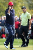 Jason Dufner of the USA reacts to a putt on the eighth green as Francesco Molinari of Europe looks on during the Morning Foursome Matches for The...