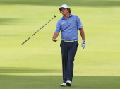 Jason Dufner of the USA throws his club into the air after hitting his 2nd shot on the 15th hole into a bunker during round four of the Perth...