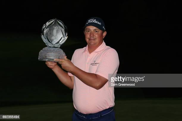 Jason Dufner poses with the tournament trophyafter winning the Memorial Tournament at Muirfield Village Golf Club on June 4 2017 in Dublin Ohio