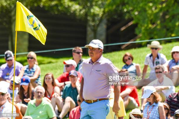 Jason Dufner smiles as he looks towards the pin flag on the ninth hole green during the second round of the Memorial Tournament presented by...