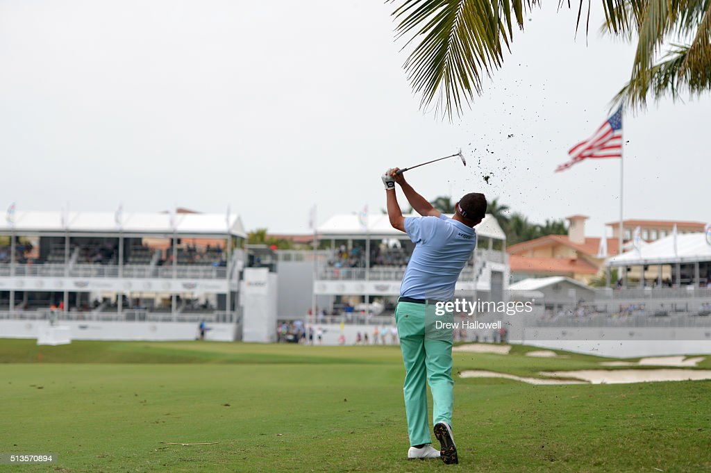 Jason Dufner takes his second shot on the 18th hole during the first round of the World Golf Championships-Cadillac Championship at Trump National Doral Blue Monster Course on March 3, 2016 in Doral, Florida.
