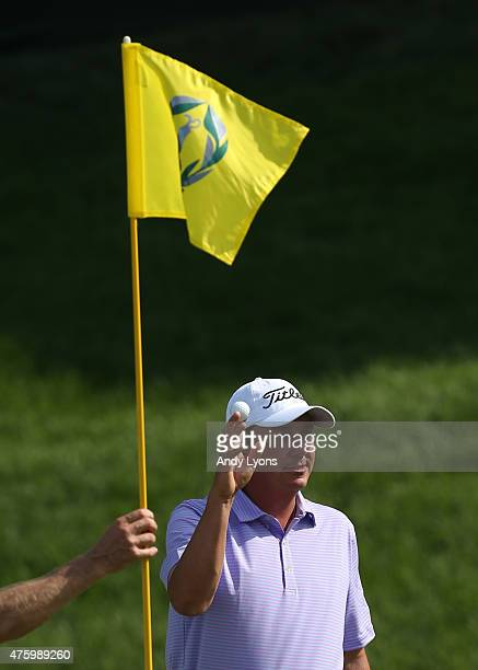 Jason Dufner waves to the gallery after a hole in one on the 16th hole during the second round of The Memorial Tournament presented by Nationwide at...