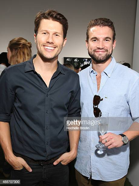 Jason Dundas and Alex Russell attend the MUSE Exhibition At De Re Gallery on September 18 2014 in Los Angeles California