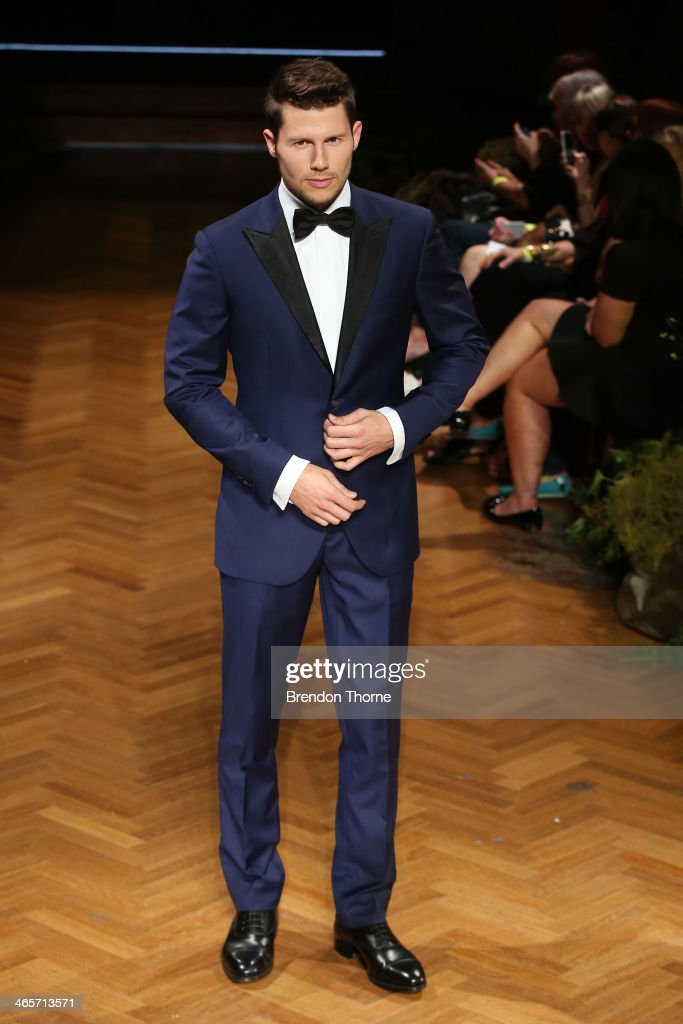 <a gi-track='captionPersonalityLinkClicked' href=/galleries/search?phrase=Jason+Dundas&family=editorial&specificpeople=578396 ng-click='$event.stopPropagation()'>Jason Dundas</a> showcases designs by MJ Bale during rehearsal for the David Jones A/W 2014 Collection Launch at the David Jones Elizabeth Street Store on January 29, 2014 in Sydney, Australia.
