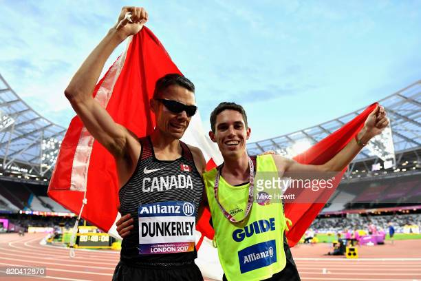 Jason Dunkerley of Canada and his guide Nathaniel Jeremie Venne celebrate after finishing second in the Mens 1500m T11 final during day eight of the...