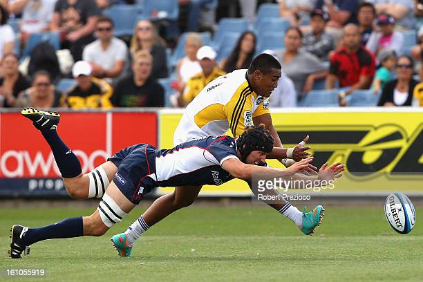 Jason Eaton of the Hurricanes attempts to score a try as Tim Davidson of the Rebels intercepts during a Super Rugby trial match between the Rebels...