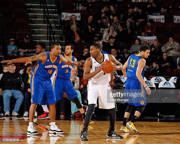 Jason Ellis of the Idaho Stampede looks for a pass around Dominic McGuire of the Santa Cruz Warriors during an NBA DLeague game on February 28 2014...