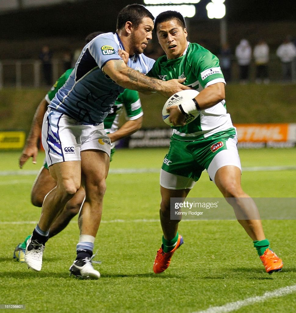 Jason Emery of Manawatu fends off Rene Ranger (L) of Northland during the round four ITM Cup match between Northland and Manawatu at Toll Stadium on September 5, 2012 in Whangarei, New Zealand.
