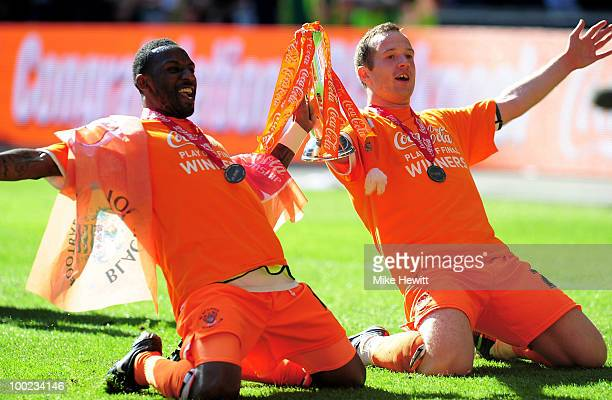 Jason Euell and captain Charlie Adam of Blackpool celebrate after the Championship Play off trophy the Coca Cola Championship Playoff Final between...