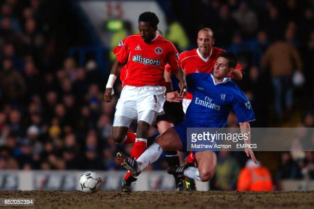 Jason Euell of Charlton Athletic gets tackled by Frank Lampard of Chelsea