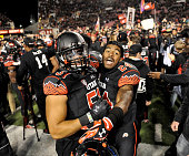 Jason Fanaika and Kenric Young of the Utah Utes celebrate their 2421 win over the USC Trojans at RiceEccles Stadium on October 25 2014 in Salt Lake...