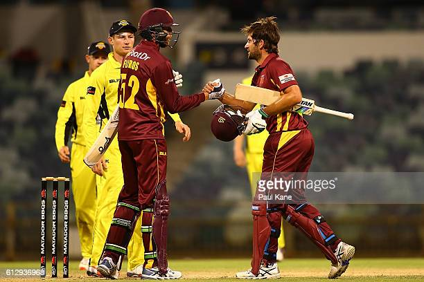 Jason Floros and Joe Burns of the Bulls celebrate after winning the Matador BBQs One Day Cup match between Western Australia and Queensland at WACA...