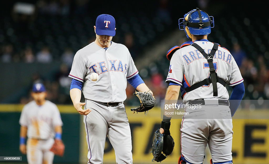 Jason Frasor #44 of the Texas Rangers reacts to allowing a two-run home run by George Springer of the Houston Astros in the seventh inning as J.P. Arencibia #7 looks on during their game at Minute Maid Park on May 14, 2014 in Houston, Texas.