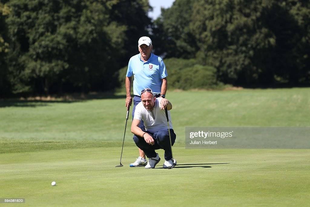 Jason Fullard of Torquay Golf Club discusses a putt with his partner Malcolm Swift during The PGA ProCaptain South West Qualifier at Bowood Golf...