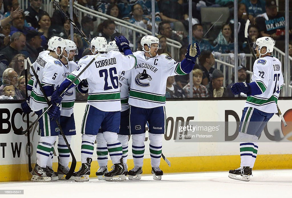 Jason Garrison #5, Alex Burrows #14, Frank Corrado #26, Henrik Sedin #33 and Daniel Sedin #22 of the Vancouver Canucks celebrate after scoring against the San Jose Sharks in Game Three of the Western Conference Quarterfinals during the 2013 NHL Stanley Cup Playoffs at HP Pavilion on May 5, 2013 in San Jose, California. The Sharks defeated the Canucks 5-2.