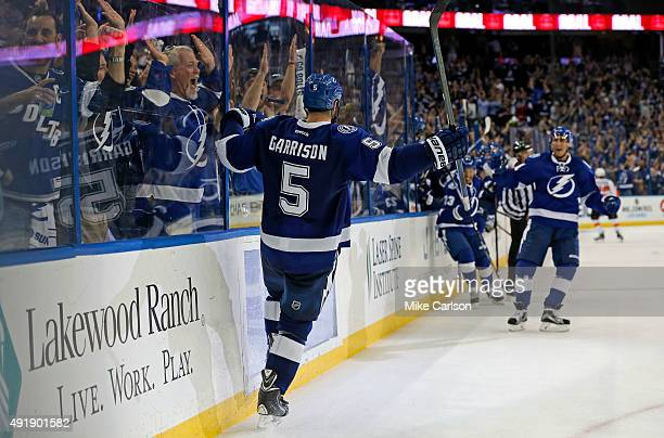 Jason Garrison of the Tampa Bay Lightning celebrates his overtime goal against the Philadelphia Flyers at the Amalie Arena on October 8 2015 in Tampa...