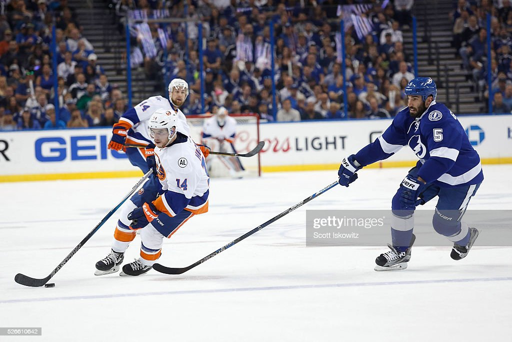 <a gi-track='captionPersonalityLinkClicked' href=/galleries/search?phrase=Jason+Garrison&family=editorial&specificpeople=2143635 ng-click='$event.stopPropagation()'>Jason Garrison</a> #5 of the Tampa Bay Lightning chases Thomas Hickey #14 of the New York Islanders with the puck during the first period in Game Two of the Eastern Conference Second Round during the 2016 NHL Stanley Cup Playoffs at Amalie Arena on April 30, 2016 in Tampa, Florida.