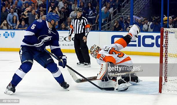 Jason Garrison of the Tampa Bay Lightning scores an overtime goal past Steve Mason of the Philadelphia Flyers at the Amalie Arena on October 8 2015...