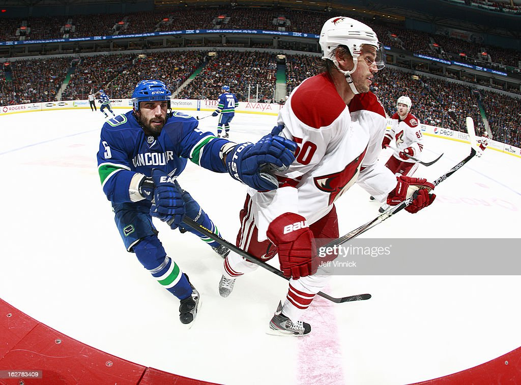 <a gi-track='captionPersonalityLinkClicked' href=/galleries/search?phrase=Jason+Garrison&family=editorial&specificpeople=2143635 ng-click='$event.stopPropagation()'>Jason Garrison</a> #5 of the Vancouver Canucks checks <a gi-track='captionPersonalityLinkClicked' href=/galleries/search?phrase=Antoine+Vermette&family=editorial&specificpeople=206302 ng-click='$event.stopPropagation()'>Antoine Vermette</a> #50 of the Phoenix Coyotes during their NHL game at Rogers Arena February 26, 2013 in Vancouver, British Columbia, Canada. Phoenix won 4-2.