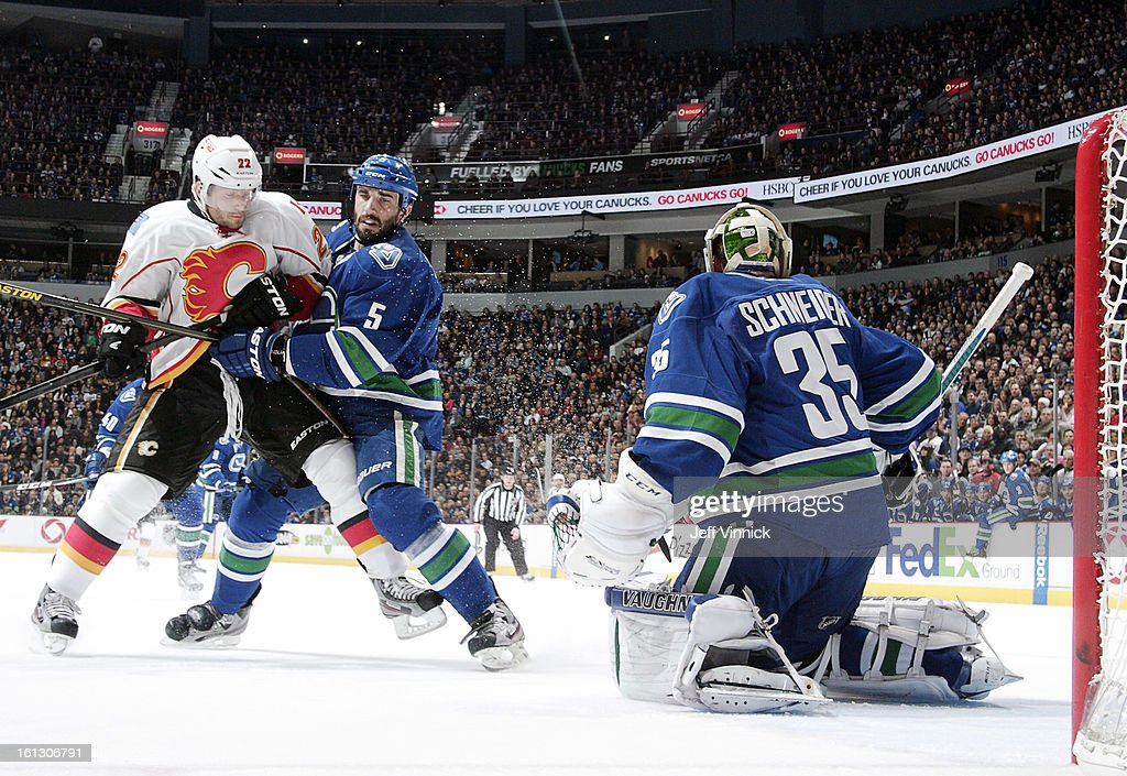 <a gi-track='captionPersonalityLinkClicked' href=/galleries/search?phrase=Jason+Garrison&family=editorial&specificpeople=2143635 ng-click='$event.stopPropagation()'>Jason Garrison</a> #5 of the Vancouver Canucks contains <a gi-track='captionPersonalityLinkClicked' href=/galleries/search?phrase=Lee+Stempniak&family=editorial&specificpeople=575240 ng-click='$event.stopPropagation()'>Lee Stempniak</a> #22 of the Calgary Flames in front of <a gi-track='captionPersonalityLinkClicked' href=/galleries/search?phrase=Cory+Schneider&family=editorial&specificpeople=696908 ng-click='$event.stopPropagation()'>Cory Schneider</a> #35 of the Vancouver Canucks during their NHL game at Rogers Arena February 9, 2013 in Vancouver, British Columbia, Canada. Vancouver won 5-1.