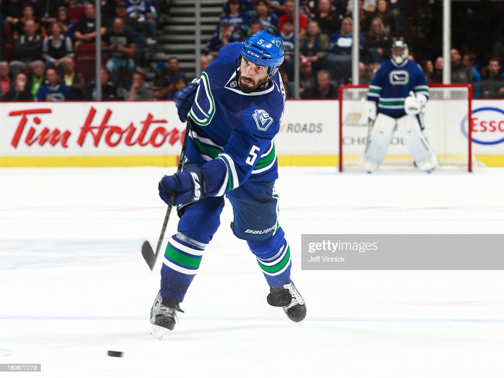 <a gi-track='captionPersonalityLinkClicked' href=/galleries/search?phrase=Jason+Garrison&family=editorial&specificpeople=2143635 ng-click='$event.stopPropagation()'>Jason Garrison</a> #5 of the Vancouver Canucks fires a shot at the New Jersey Devils goal during their NHL game at Rogers Arena on October 8, 2013 in Vancouver, British Columbia, Canada. Vancouver won 3-2.