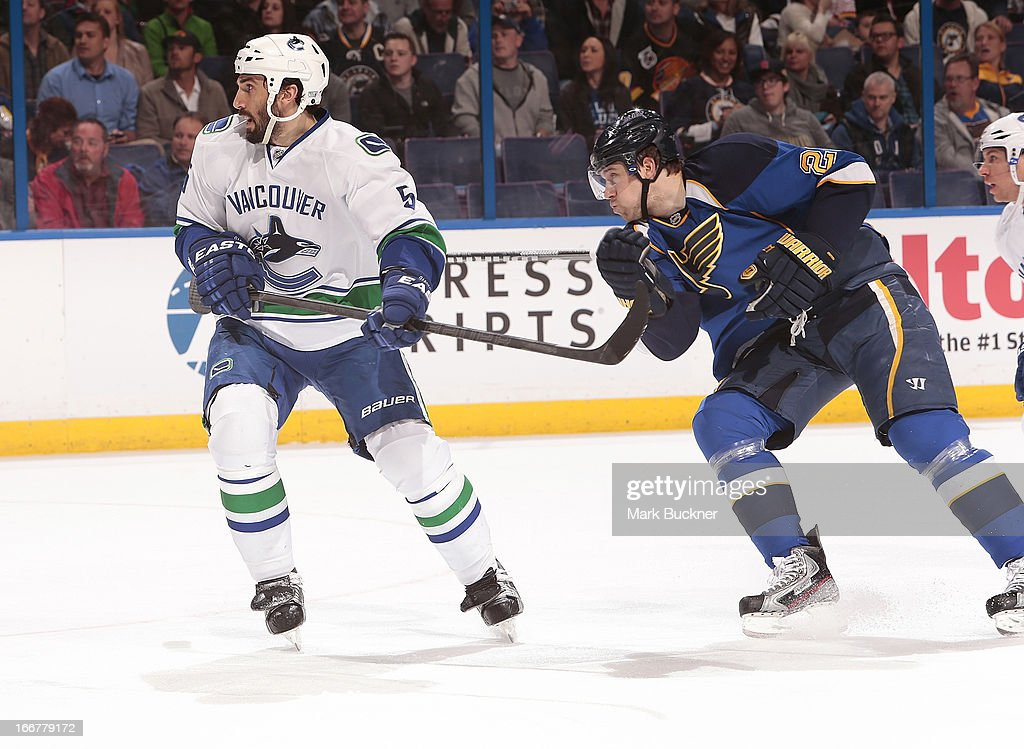 <a gi-track='captionPersonalityLinkClicked' href=/galleries/search?phrase=Jason+Garrison&family=editorial&specificpeople=2143635 ng-click='$event.stopPropagation()'>Jason Garrison</a> #5 of the Vancouver Canucks skates against <a gi-track='captionPersonalityLinkClicked' href=/galleries/search?phrase=Patrik+Berglund&family=editorial&specificpeople=540481 ng-click='$event.stopPropagation()'>Patrik Berglund</a> #21 of the St. Louis Blues in an NHL game on April 16, 2013 at Scottrade Center in St. Louis, Missouri.
