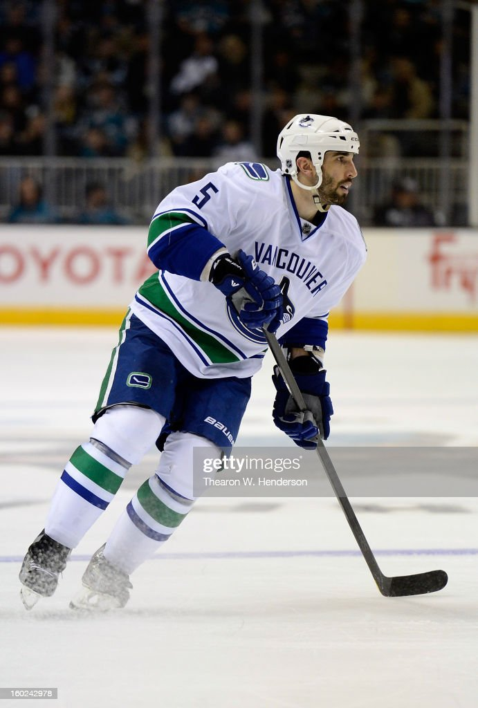 Jason Garrison #5 of the Vancouver Canucks skates against the San Jose Sharks at HP Pavilion on January 27, 2013 in San Jose, California.