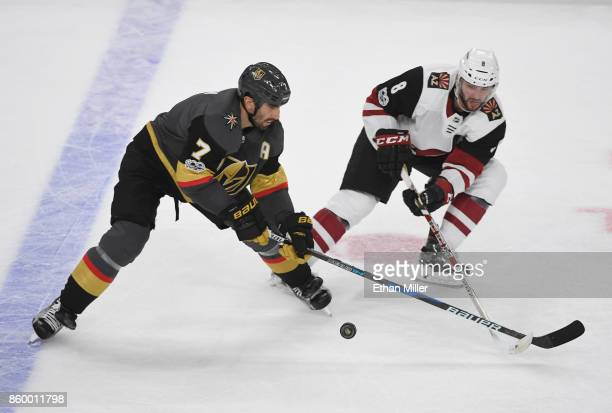Jason Garrison of the Vegas Golden Knights skates with the puck against Tobias Rieder of the Arizona Coyotes in the second period of the Golden...