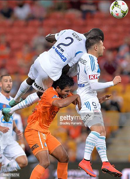 Jason Geria and Kosta Barbarouses of the Victory get above Jean Carlos Solorzano of the Roar as they compete for the ball during the round 18 ALeague...