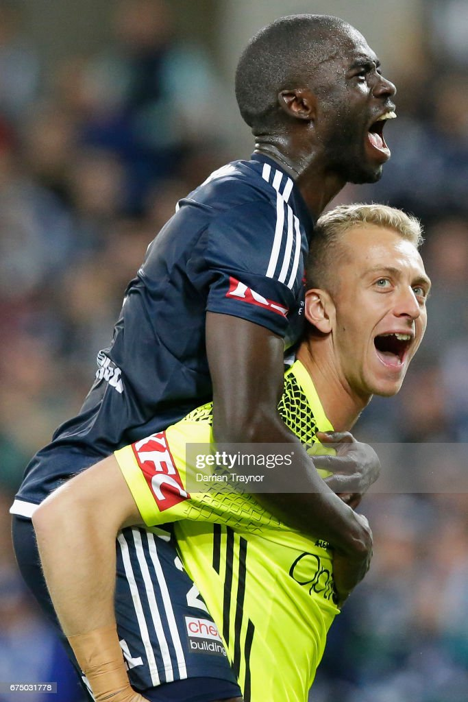 Jason Geria and Victory goalkeeper Lawrence Thomas celebrate their teams win during the A-League Semi Final match between Melbourne Victory and the Brisbane Roar at AAMI Park on April 30, 2017 in Melbourne, Australia.