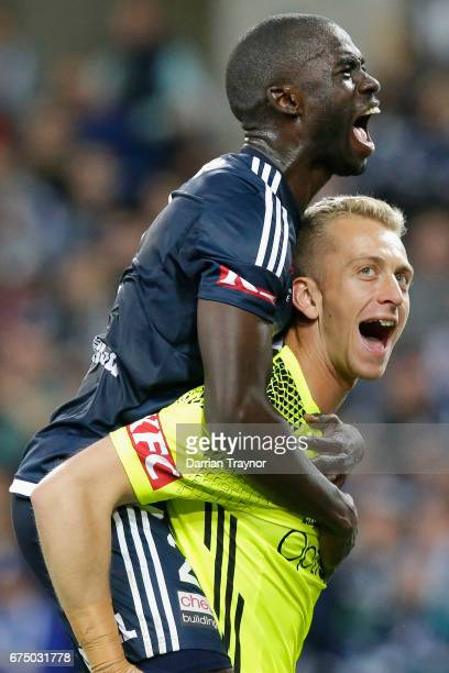 Jason Geria and Victory goalkeeper Lawrence Thomas celebrate their teams win during the ALeague Semi Final match between Melbourne Victory and the...