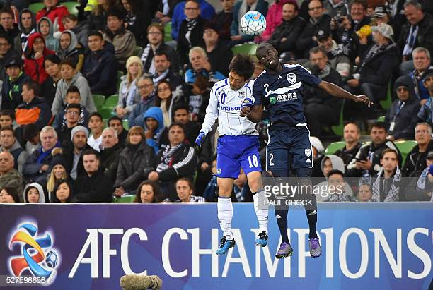 Jason Geria of Melbourne Victory leaps for the ball against Takahiro Futagawa of Gamba Osaka during the AFC Champions League football match between...