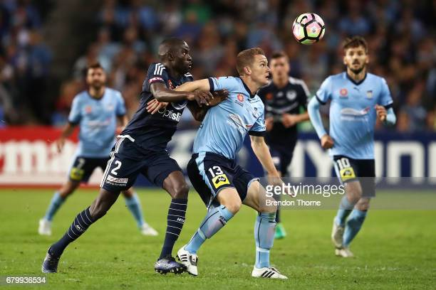 Jason Geria of the Victory competes with Brandon O'Neill of Sydney during the 2017 ALeague Grand Final match between Sydney FC and the Melbourne...