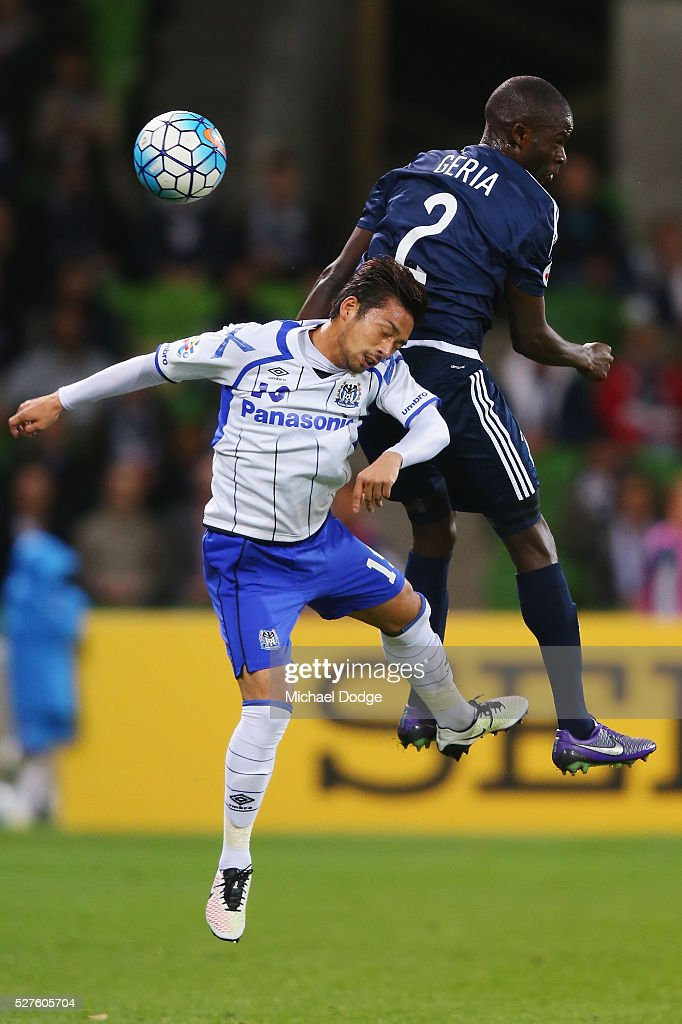 Jason Geria of the Victory heads the ball over Kotaro Omori of Gamba Osaka during the AFC Champions League match between Melbourne Victory and Gamba Osaka at AAMI Park on May 3, 2016 in Melbourne, Australia.