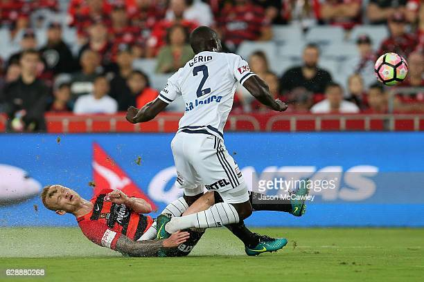 Jason Geria of the Victory is challenged by Jack Clisby of the Wanderers during the round 10 ALeague match between the Western Sydney Wanderers and...