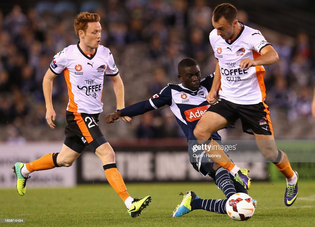 Jason Geria of the Victory tackles Ivan Franjic of the Roar during the round three A-League match between Melbourne Victory and Brisbane Roar at Etihad Stadium on October 25, 2013 in Melbourne, Australia.