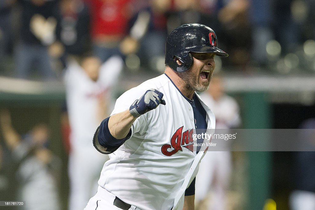 Jason Giambi of the Cleveland Indians celebrates after hiting a walkoff tworun home run to defeat the Chicago White Sox at Progressive Field on...